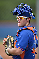 New York Mets catcher Jeff Glenn (4) in the bullpen during a minor league spring training game against the St. Louis Cardinals on March 27, 2014 at the Port St. Lucie Training Complex in Port St. Lucie, Florida.  (Mike Janes/Four Seam Images)