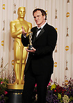 HOLLYWOOD, CA - FEBRUARY 24: Quentin Tarantino poses in the press room the 85th Annual Academy Awards at Dolby Theatre on February 24, 2013 in Hollywood, California.