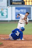Austin Bailey (7) of the Burlington Royals makes a throw to first base as Brandon Dulin (31) of the Burlington Royals slides into second base at Boyce Cox Field on July 10, 2015 in Bristol, Virginia.  The Pirates defeated the Royals 9-4. (Brian Westerholt/Four Seam Images)