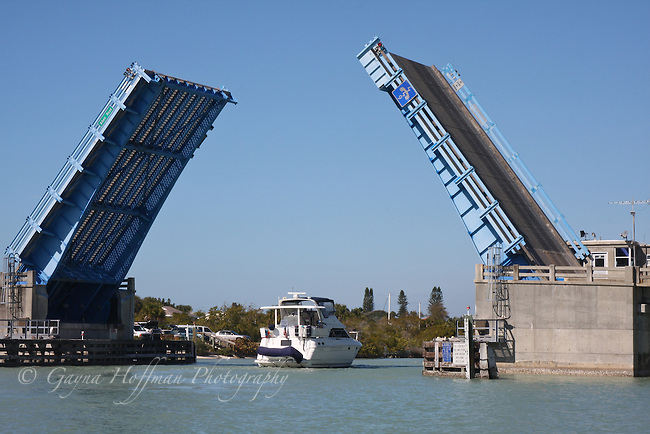 Boat passing under open drawbridge, Nokomis, FL