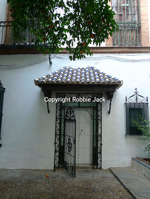 A tiled doorway in Seville, Spain.