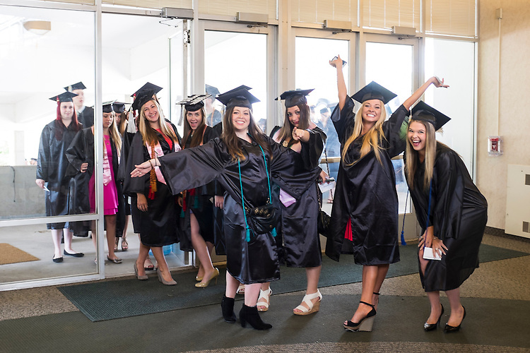 A group of students pose for a photo on their way into Undergraduate Commencement on Saturday, May 2, 2015.  Photo by Ohio University  /  Rob Hardin