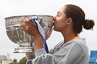 Tamira Paszek, AEGON International Champion with the Trophy, defeated Angelique Kerberby on Centre Court at Devonshire Park, Eastbourne 5-7 6-3 7-5 on 23 June 2012