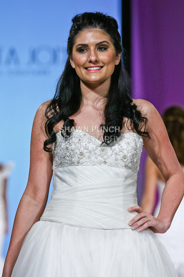 Model walks the runway in Tilda by Augusta Jones. This English net ball gown is complimented by hand beaded lace and net bodice with a sweetheart neckline and drop waist. During the Wedding Trendspot Press Fashion Show at the Waldorf-Astoria; October 18 2009