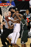 UCLA Bruins Lazeric Jones #11 goes up for a layup under Michigan State Spartans guard Keith Appling #11 during the second round game of the NCAA Basketball Tournament at St. Pete Times Forum on March 17, 2011 in Tampa, Florida.  UCLA defeated Michigan State 78-76.  (Mike Janes/Four Seam Images)