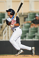 Marcus Semien #6 of the Kannapolis Intimidators follows through on his swing against the Lakewood BlueClaws at Fieldcrest Cannon Stadium on July 17, 2011 in Kannapolis, North Carolina.  The BlueClaws defeated the Intimidators 4-3.   (Brian Westerholt / Four Seam Images)