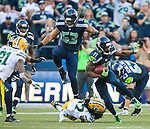 Seattle Seahawks wide receiver and kickoff specialists Percy Harvin (11) returns a kickoff 31 yards against the Green Bay Packers during the quarter of the NFL Kickoff held at CenturyLink Field September 4, 2014 in Seattle. Harvin also caught seven passes for 59 yards. The Seahawks pounded the packers 36-16. ©2014  Jim Bryant Photo. ALL RIGHTS RESERVED.