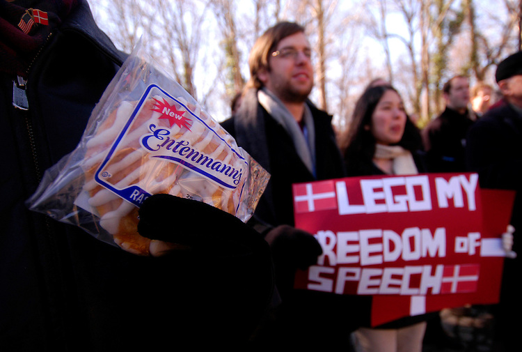 "A ""Stand By Denmark"" rally at the Danish Embassy, with supporters holding Danishes, lego toys, and signs for free speech regarding the Mohammed cartoon controversy and to protest the Danish economic boycott. The rally, organized by columnist Christopher Hitchens, drew more than a hundred people."