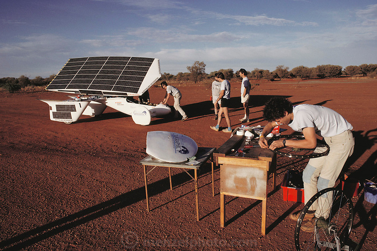 Dick Smith's solar car getting a tire fixed on November 7, Pentax Solar Car Race, near Kulgera, Australia. Pentax World Solar Challenge, the first international solar-powered car race. The event began in Darwin, Northern Territories on November 1st, 1987 and finished in Adelaide, South Australia completing 1,950 miles.