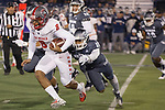 New Mexico quarterback Tevaka Tuioti (8) is tackled Nevada defensive back Austin Arnold (28) in the first half of an NCAA college football game in Reno, Nev., Saturday, Nov. 2, 2019. (AP Photo/Tom R. Smedes)