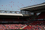 Red balloons are released from the pitch at Liverpool Football Club's Anfield Stadium during a memorial service to mark the 25th anniversary of the 1989 Hillsborough stadium disaster. The Hillsborough disaster led to 96 Liverpool football fans losing their lives in a crush at an FA Cup semi final tie against Nottingham Forest. The families of the victims campaigned against the original verdict of the incident and were rewarded with a new inquiry held in 2014 into events at the match at Hillsborough. Photo by Colin McPherson.