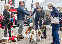 Prince William Duke of Cambridge and Kate Duchess of Cambridge Katherine Catherine Middleton meet Kerry Irving and wife Angela with their three dogs Max, Paddy, and Harry during a visit to the market town of Keswick in Cumbria where they join a celebration to recognise the contribution of individuals and local organisations in supporting communities and families across Cumbria. They meet volunteers including those from the local mountain rescue service, community first responders, young people trained as mental health first aiders and other organisations that have benefitted from grants from the Cumbria Community Foundation. Photo Credit: ALPR/AdMedia