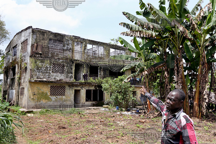 Paulinus Agala looks at his house, destroyed during inter-communal violence.<br /> The Rumuekpe community suffered much damage during the conflict among various rival militants and cult gangs over access to oil money. The inter-communal violence killed many people, including women and children, between 2005-08. Thousands more were displaced by fighting that left homes, schools and churches in ruins with many suffering poverty and homelessness.