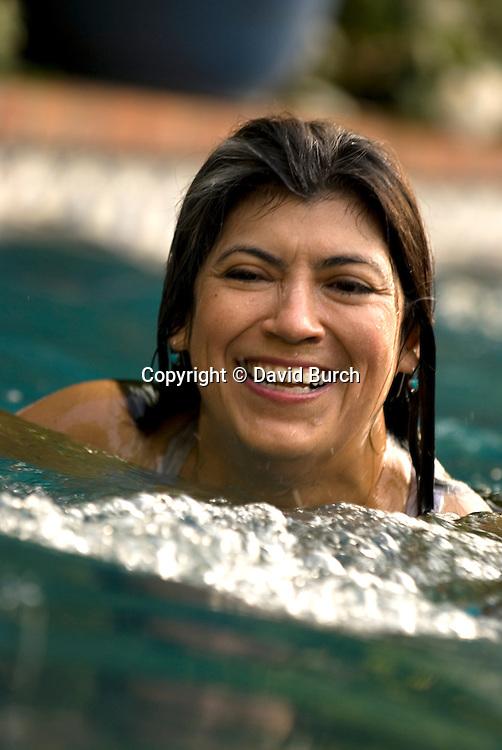 Hipanic woman swimming