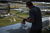 """Lucerne, SWITZERLAND, 12th July 2018, Thursday """"Hudson Boat"""" Technician, """"polishing, an Eight"""",  FISA World Cup III, Lake Rotsee, © Peter SPURRIER,"""