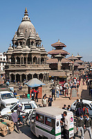 Nepal, Patan.  Mid-day Traffic at the Entrance to Durbar Square, Krishna Temple (Chyasim Deval) on left.  February 18, 2009.  The temple survived the earthquake of April 2015.