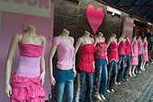 Headless tailor's dummies displaying cheap fashion clothing for young people in Camden Lock market, London.
