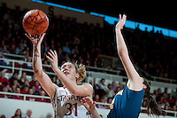 STANFORD, CA-JANUARY 28, 2011: Toni Kokenis finishes a fast break during a 74-71 overtime win over the Cal Bears.