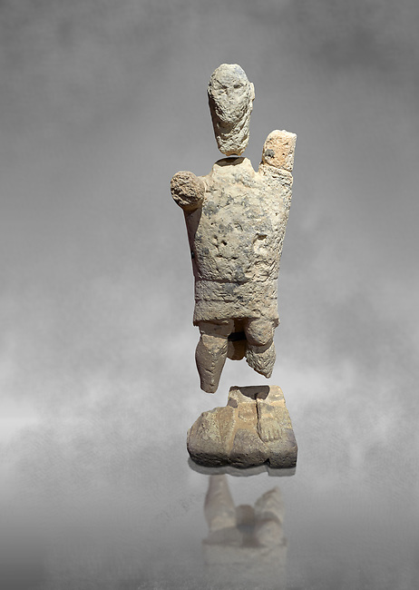 9th century BC Giants of Mont'e Prama  Nuragic stone statue of a boxer, Mont'e Prama archaeological site, Cabras. 2014 excavation. Civico Museo Archeologico Giovanni Marongiu - Cabras, Sardinia. Art grey background