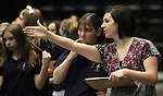 Members of the Roy Gomm Elementary School Choir prepare to sing the National Anthem before Friday night's Reno Bighorns minor league basketball game, Feb. 11, 2011, against the Fort Wayne Mad Ants at the Reno Events Center in Reno, Nev. .Photo by Cathleen Allison