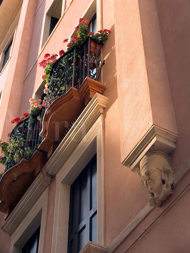 Flowers decorate balcony window of building on Via dell'Arco, Padua Ital