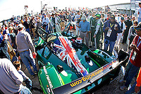 The #8 Drayson Racing Lola of Paul Drayson, Jonny Cocker and Emmanuele Pirro is surrounded by fans on the grid before the 12 Hours of Sebring, Sebring, FL, MArch 20, 2010.  (Photo by Brian Cleary/www.bcpix.com)