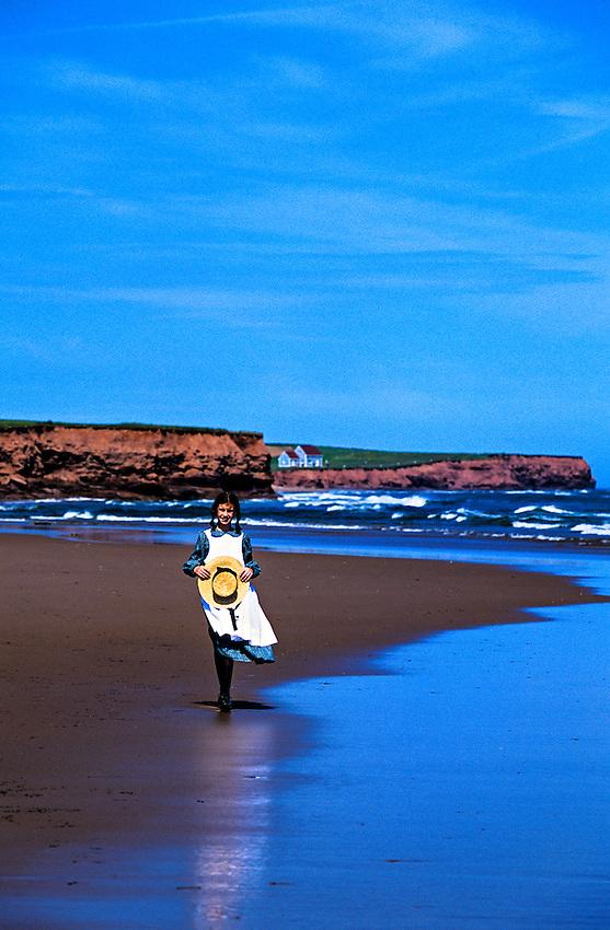 "Girl portraying ""Anne of Green Gables"" on beach near Park Corner, Prince Edward Island, Canada"