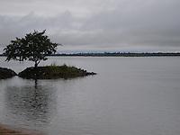 Rio Parana at dusk. Paraguay urban, rural and indigenous communities