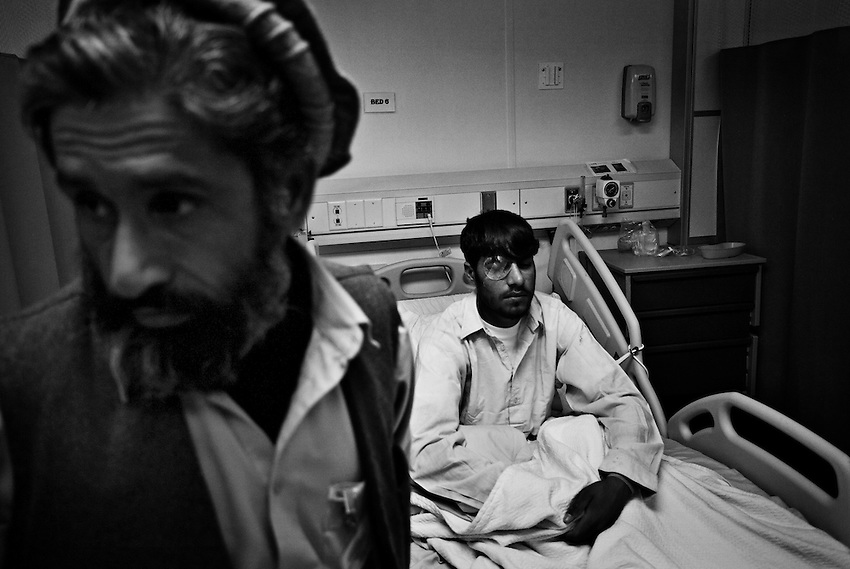 Fateh Rahman, 20, a member of the Afghan National Police, recovers from an eye wound at the SSG Heathe N. Craig Joint Theater Military Hospital at Bagram Airbase, Afghanistan, Saturday, January 17, 2009. Rahman was injured when a rifle discharged accidentally in the truck he was riding in on January 6, 2009, killing another policeman.