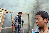 Tibetan children in a village in the region of Aba. South-east Tibetan Plateau, in Sichuan Province, western China.