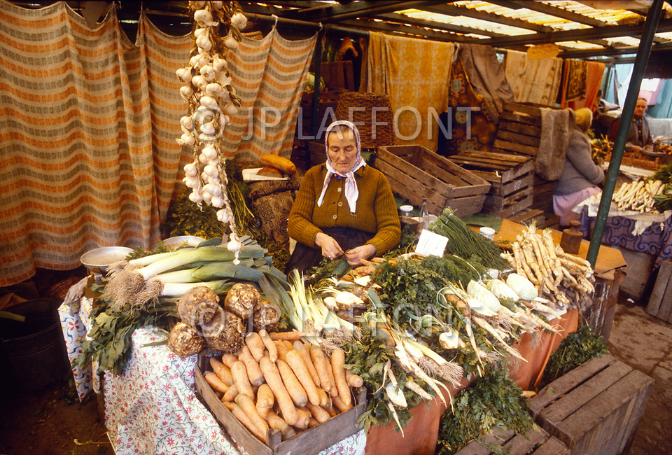 Poland, September, 1981 - A woman selling produce in the Warsaw market.