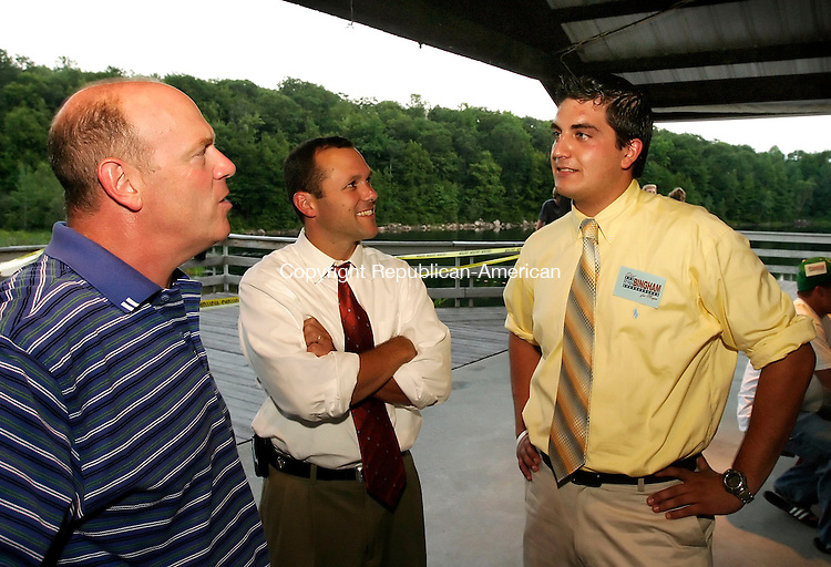 TORRINGTON, CT - 10 AUGUST 2005 -081005JS01-- Torrington Republican mayoral candidate Ryan Bingham, right, talks with Dr. Rob Crovo of Harwinton, left and D.C.F. Chief of Staff Brian Mattiello, center, during the Torrington Republican Town Committee's picnic fundraiser Wednesday at Elks Pond in Torrington.  --Jim Shannon Photo--Ryan Bingham; Dr. Rob Crovo; Brian Mattiello, Elks Pond,Torrington are CQ
