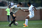 10 September 2016: Wake Forest's Jon Bakero (ESP) (7) and Virginia's Robin Afamefuna (30). The Wake Forest University Demon Deacons hosted the University of Virginia Cavaliers in a 2016 NCAA Division I Men's Soccer match. Wake Forest won the game 1-0 in sudden death overtime.