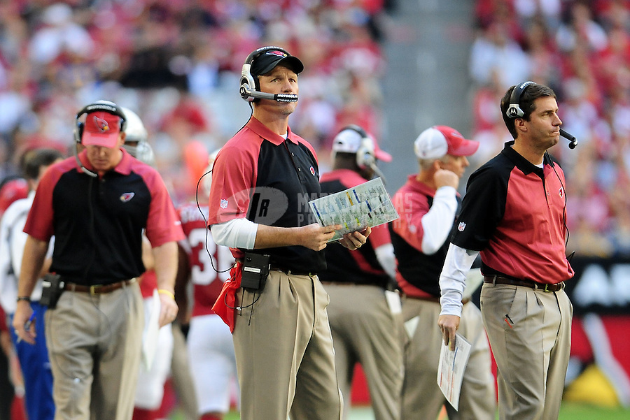 Dec. 5, 2010; Glendale, AZ, USA;  Arizona Cardinals head coach Ken Whisenhunt (center) and receivers coach John McNulty (right) against the St. Louis Rams at University of Phoenix Stadium. The Rams defeated the Cardinals 19-6. Mandatory Credit: Mark J. Rebilas-