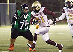WATERBURY CT. 22 November 2017-112217SV15-#21 Nefali McNeil of Sacred Heart/Kaynor runs for yardage as #75 Gavin Ayers of Wilby High defends at Municipal Stadium in Waterbury Wednesday.<br /> Steven Valenti Republican-American