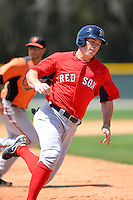 Boston Red Sox first baseman Mike Flacco #17 rounds third during a minor league Spring Training game against the Baltimore Orioles at Buck O'Neil Complex on March 25, 2013 in Sarasota, Florida.  (Mike Janes/Four Seam Images)