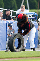 Batavia Muckdogs mascot Homer helps in an on field promotion during a game against the Jamestown Jammers at Dwyer Stadium on June 27, 2011 in Batavia, New York.  Batavia defeated Jamestown 4-3.  (Mike Janes/Four Seam Images)