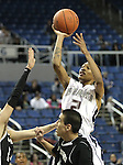 DeCari Lide takes a shot for Agassi Prep during the NIAA 2A State Basketball Championship game between West Wendover and Agassi Prep high schools at Lawlor Events Center, in Reno, Nev, on Saturday, Feb. 25, 2012. .Photo by Cathleen Allison