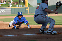 Round Rock Express outfielder Julio Borbon #20 slides into third base during the Pacific Coast League baseball game against the Fresno Grizzlies on May 19, 2012 at The Dell Diamond in Round Rock, Texas. The Grizzlies defeated the Express 10-4. (Andrew Woolley/Four Seam Images)