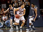 SIOUX FALLS, SD: MARCH 22: Jarek Coles #21 of Bellarmine looks past Colorado Mines defenders Gokul Natesan #31 and Ben Clare #32 during the Men's Division II Basketball Championship Tournament on March 22, 2017 at the Sanford Pentagon in Sioux Falls, SD. (Photo by Dick Carlson/Inertia)