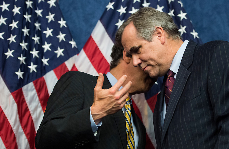 UNITED STATES - JULY 21: Sen. Sherrod Brown, D-Ohio, left, and Sen. Jeff Merkley, D-Ore., talk during the Senate Democrats' news conference to highlight the fifth anniversary of Dodd-Frank financial reform legislation on Tuesday, July 21, 2015. (Photo By Bill Clark/CQ Roll Call)