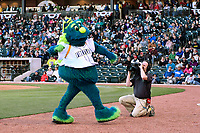 Mascot Mason of the Columbia Fireflies gets the crowd fired up during the game against the Augusta GreenJackets on Opening Day, Thursday, April 6, 2017, at Spirit Communications Park in Columbia, South Carolina. (Tom Priddy/Four Seam Images)