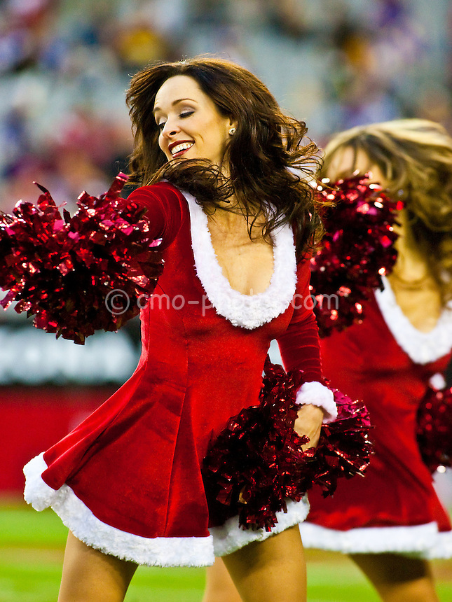 Dec 14, 2008; Glendale, AZ, USA; An Arizona Cardinals cheerleader dances in a Santa Claus costume during the two-minute warning in the fourth quarter of a game between the Minnesota Vikings and the Arizona Cardinals at University of Phoenix Stadium.  The Vikings won the game 35-14.