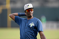 Shortstop Ronny Mauricio (2) of the Columbia Fireflies warms up before a game against the Lexington Legends on Friday, May 3, 2019, at Segra Park in Columbia, South Carolina. Lexington won, 5-2. (Tom Priddy/Four Seam Images)