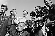 Watkins Glen, New York, USA. 01 Oct 1967. Scottish Formula One racecar driver Jim Clark (3rd from the R) of Team Lotus wins the 1967 Watkins Glen Formula One Grand Prix. British Formula One racecar driver Graham Hill (3rd from the L) placed second in the race.