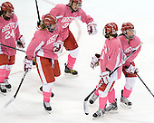 Taylor Holze (BU - 24), Shannon Stoneburgh (BU - 7), Jenn Wakefield (BU - 9), Kaleigh Fratkin (BU - 13) and Isabel Menard (BU - 20) celebrate Menard's goal. - The Boston University Terriers defeated the visiting Northeastern University Huskies 3-2 on Saturday, January 28, 2012, at Agganis Arena in Boston, Massachusetts.