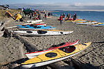 Puget Sound, Sea Kayakers, Point Wilson Lighthouse, Port Townsend, Washington State, Admiralty Inlet, Fort Worden State Park, Sea Kayaking Symposium, summer, Point 65 sea kayaks in foreground,.