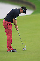 Richie Ramsay (SCO) putts on the 3rd green during Thursday's Round 1 of the 2014 BMW Masters held at Lake Malaren, Shanghai, China 30th October 2014.<br /> Picture: Eoin Clarke www.golffile.ie