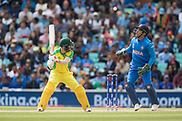 David Warner (Australia) chops the ball down and over his stumps as MS Dhoni (India) looks on  during India vs Australia, ICC World Cup Cricket at The Oval on 9th June 2019