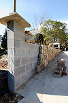 Stone and block wall under construction.  Part of Atlanta's insatiable growth, this is another 'tear down' house, replacing existing construction with quickly built 'McMansions' that instantly change the character of settled neighborhoods.